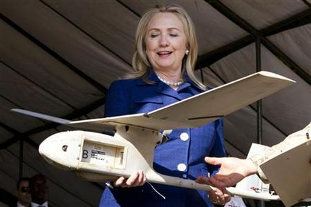U.S. Secretary of State Hillary Clinton holds a small U.S.-made drone that the Ugandan military uses in Somalia to fight al-Qaeda linked militants, during a demonstration and briefing at Kasenyi Military Base in Kampala August 3, 2012. REUTERS/Jacquelyn Martin/Pool