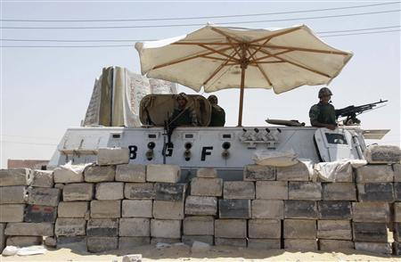 An Egyptian soldier stands guard at a checkpoint in Rafah city on the Egyptian border, August 6, 2012. REUTERS/Stringer