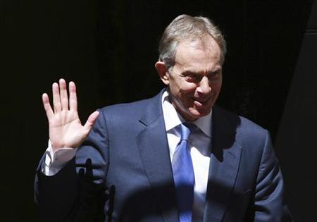 Former Prime Minister Tony Blair waves as he leaves a Diamond Jubilee lunch with Britain's Queen Elizabeth and Prime Minister David Cameron and former Prime Ministers Gordon Brown and John Major at Downing Street in central London on July 24, 2012. REUTERS/Olivia Harris