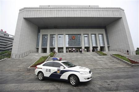 A police vehicle leaves the Hefei Intermediate People's Court, where the Gu Kailai trial will be held on Thursday, in Hefei, Anhui Province August 8, 2012. REUTERS/Aly Song