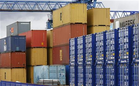Shipping containers stand in a transport yard near Liverpool, northern England, June 18, 2008. REUTERS/Phil Noble