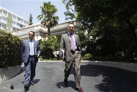 Greek Finance Minister Yannis Stournaras (R) and his alternate minister of finance Christos Staikouras leave the Prime Minister's office in Athens July 17, 2012. REUTERS/John Kolesidis