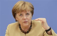 """<p>A Berlin, lors de sa traditionnelle conférence de presse de rentrée, la chancelière allemande Angela Merkel a jugé """"improbable"""" qu'un superviseur bancaire unique soit opérationnel en Europe dès le 1er janvier, mettant en garde contre une mise en oeuvre trop hâtive de la réforme. /Photo prise le 17 septembre 2012/REUTERS/Tobias Schwarz</p>"""