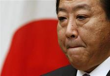 <p>Le Premier ministre japonais Yoshihiko Noda prévoit de mettre en oeuvre un nouveau programme de soutien à l'économie de 1.000 milliards de yens (9,6 milliards d'euros) pour relancer la croissance, selon des médias locaux. Les économistes doutent de l'impact à long terme de ce plan, jugé insuffisant. /Photo prise le 1er octobre 2012/REUTERS/Toru Hanai</p>