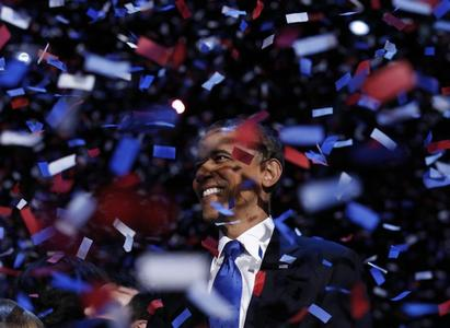 President Barack Obama celebrates on stage as confetti falls after his victory speech during his election rally in Chicago, November 6, 2012. REUTERS/Kevin Lamarque