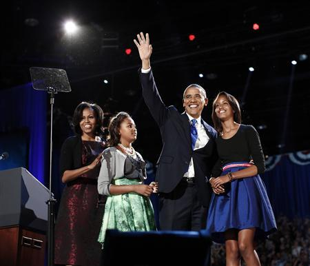 U.S. President Barack Obama gathers with his wife Michelle Obama (L) and daughters Sasha and Malia (R) during his election night victory rally in Chicago November 7, 2012. REUTERS/Jason Reed