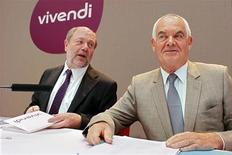 <p>Jean-Francois Dubos (à droite), le président du directoire de Vivendi, et Philippe Capron, le directeur financier. Le groupe de télécoms et de divertissement compte mettre en oeuvre dans les trimestres à venir son nouveau plan stratégique, très attendu par les investisseurs, alors que le titre en Bourse est tombé à un plus bas de neuf ans. /Photo prise le 30 août 2012/REUTERS/Mal Langsdon</p>
