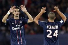 <p>Le PSG évoluera sans ses milieux de terrain Javier Pastore (de face) et Marco Verratti mardi en quarts de finale de Coupe de la Ligue à Saint-Etienne. /Photo d'archives/REUTERS/Benoît Tessier</p>