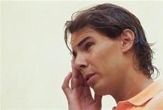 <p>Foto de archivo del tenista español Rafael Nadal durante una ronda de entrevistas en Palma de Mallorca, ago 17 2012. Rafael Nadal está intentando volver a su mejor forma a tiempo para la temporada de tierra batida y la preparación para Roland Garros, dijo el lunes el tenista español. REUTERS/Enrique Calvo</p>
