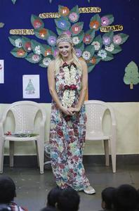 Socialite Paris Hilton poses for a photograph during her visit to an orphanage in Mumbai, December 3, 2012. REUTERS/Danish Siddiqui
