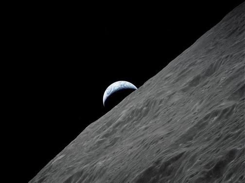 The crescent Earth rises above the lunar horizon in this undated NASA handout photograph taken from the Apollo 17 spacecraft in lunar orbit during the final lunar landing mission in the Apollo program. December 13, 2012 marks the 50th anniversary of the last manned lunar trip.   REUTERS/NASA/Handout