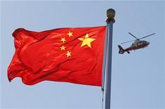 <p>La Chine assurera la stabilité de sa politique économique en 2013 tout en conservant des marges de manoeuvre pour s'adapter aux risques mondiaux et en approfondissant les réformes entreprises pour assurer sa croissance à long terme, a rapporté dimanche l'agence de presse officielle Chine nouvelle après une réunion de dirigeants du pays. /Photo prise le 9 octobre 2012/REUTERS/David Gray</p>
