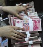 <p>Selon le directeur de recherche de la banque centrale chinoise, Pékin n'est pas confronté à un risque inflationniste et n'aura pas besoin de mener une politique monétaire agressive l'année prochaine. /Photo d'archives/REUTERS</p>