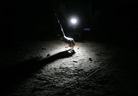 A cameraman records as a forensic investigator inspect bullet shells at a crime scene after a shooting at Ameca town outside Guadalajara January 12, 2013.   REUTERS/Alejandro Acosta