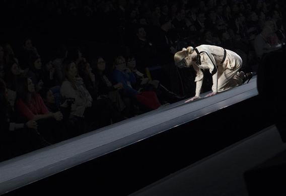A model falls as she presents a creation from designer Miguel Palacio's Fall-Winter 2012 collection during the Mercedes-Benz Fashion Week in Madrid, February 2, 2012. REUTERS-Juan Medina