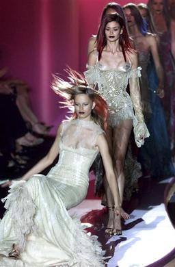 A model slips on her gown and falls to the catwalk at the end of Italian designer Donatella Versace's Autumn-Winter 2002-2003 Haute Couture collection in Paris, July 8, 2002. REUTERS-John Schults