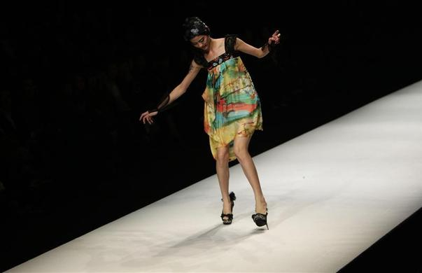 A model nearly falls as she presents a creation by Chinese designer Qi Gang during a fashion show at China Fashion Week for Spring-Summer 2012 in Beijing, October 27, 2011. REUTERS-Jason Lee