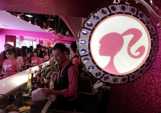 Employees serve customers during the media preview of a Barbie-themed cafe in Taipei January 30, 2013. The 660-square-metre ''Barbie Cafe'', fashioned with Mattel's barbie dolls themed decor and food dishes, will open January 31 along Taipei's Zhongxiao Dunhua shopping belt. REUTERS/Pichi Chuang