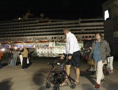 Crippled cruise ship docks