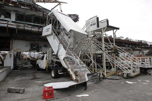 Damaged passenger boarding stairs are seen after super Typhoon Haiyan battered Tacloban city, central Philippines, November 9, 2013. REUTERS-Romeo Ranoco