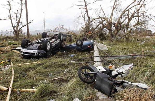 Overturned vehicles are seen at a rice field after super Typhoon Haiyan battered Tacloban city, central Philippines, November 9, 2013. REUTERS-Romeo Ranoco