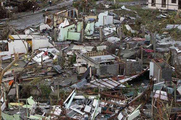 Damaged houses near the airport are seen after super Typhoon Haiyan battered Tacloban city, central Philippines, November 9, 2013. REUTERS-Romeo Ranoco