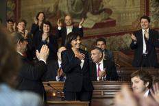 La socialiste Anne Hidalgo a été élue samedi maire de Paris, où elle succède comme prévu à Bertrand Delanoë. Le premier Conseil de Paris depuis le scrutin l'a élue avec 91 voix sur 163, faisant d'elle la première femme à diriger la capitale.  /Photo prise le 31 mars 2014/REUTERS/Philippe Wojazer