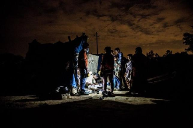 People in an urban slum in Bangalore use a solar lantern. Picture February 13 2013, Pollinate Energy