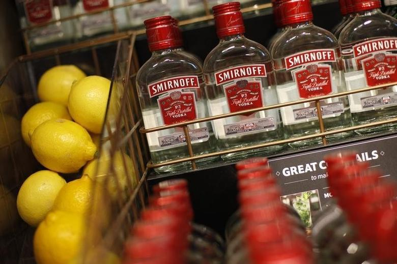 Smirnoff vodka and lemons are displayed in the liquor aisle at a Tesco Extra supermarket in Watford, north of London August 8, 2013. REUTERS/Suzanne Plunkett/Files