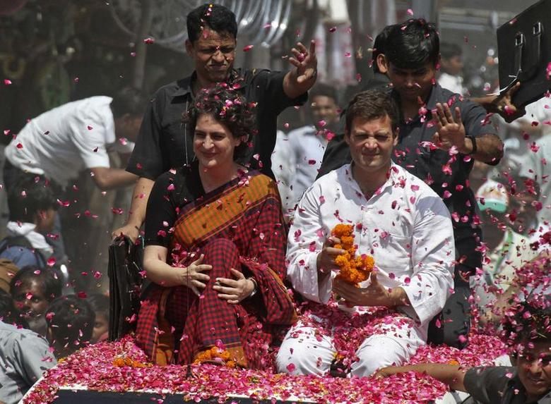 Rahul Gandhi (in white), ruling Congress party vice president and son of Congress chief Sonia Gandhi, and his sister Priyanka Gandhi Vadra are showered with rose petals by their supporters upon Rahul's arrival to file his nomination for the general election at Amethi, in Uttar Pradesh April 12, 2014. REUTERS/Pawan Kumar