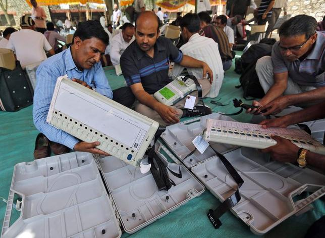 Election staff check electronic voting machines (EVM) at a distribution centre ahead of the fifth phase of general election at Sirohi district in Rajasthan April 16, 2014. REUTERS/Amit Dave