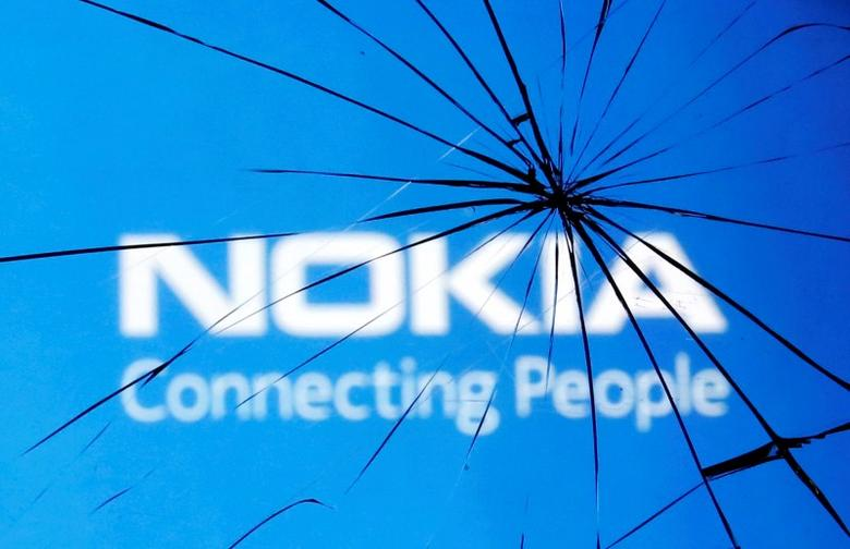An illustration picture shows Nokia logo through a broken glass in the central Bosnian town of Zenica January 23, 2014.  REUTERS/Dado Ruvic/Files