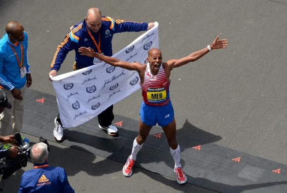 Apr 21, 2014; Boston, MA, USA; Meb Keflezighi of the United States celebrates after winning the 2014 Boston Marathon. Mandatory Credit: Greg M. Cooper-USA TODAY