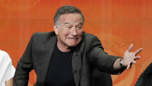 Cast member Robin Williams gestures at a panel for the television series ''The Crazy Ones'' during the CBS portion of the Television Critics Association Summer press tour in Beverly Hills, California July 29, 2013. REUTERS/Mario Anzuoni/Files