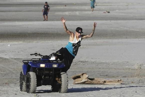Canadian singer Justin Bieber jumps from a quad bike at a resort in Punta Chame, on the outskirts of Panama City January 27, 2014. REUTERS/Carlos Jasso /Files