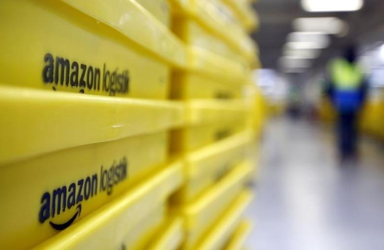Boxes are pictured at Amazon's logistics centre in Graben near Augsburg December 16, 2013. REUTERS/Michaela Rehle/Files