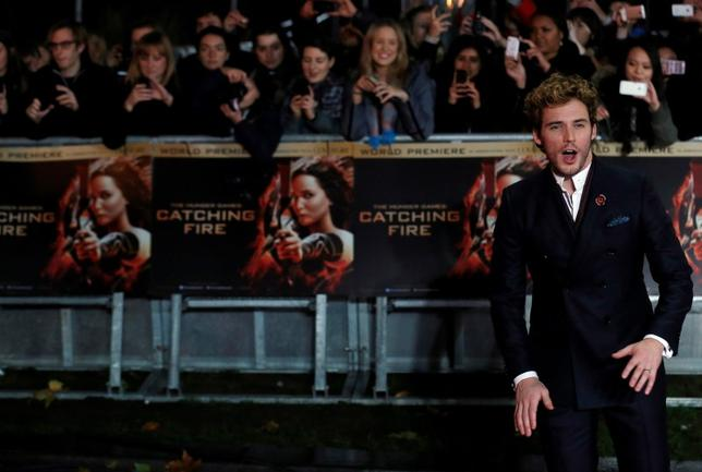 Actor Sam Claflin reacts as he arrives for the world premiere of ''The Hunger Games : Catching Fire'' at Leicester Square in London November 11, 2013. REUTERS/Luke MacGregor