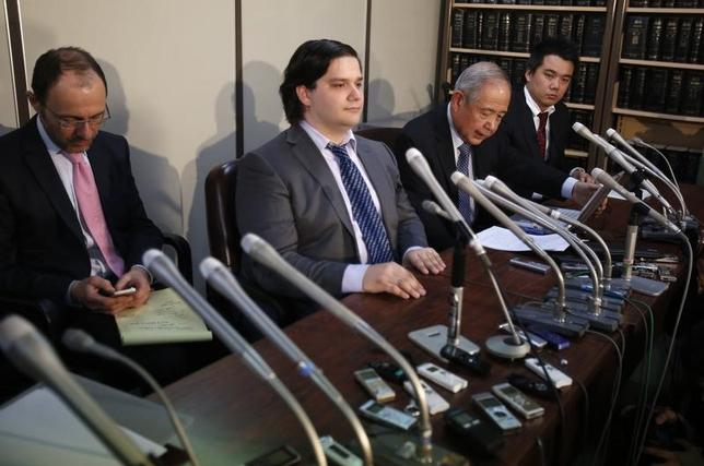 Mark Karpeles (2nd L), chief executive of Mt. Gox, attends a news conference at the Tokyo District Court in Tokyo February 28, 2014. REUTERS/Yuya Shino/Files