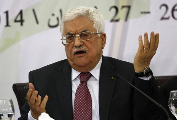 Palestinian President Mahmoud Abbas gestures as he address the Palestinian Liberation Organization's (PLO) central council in the West Bank City of Ramallah April 26, 2014. REUTERS/Mohamad Torokman