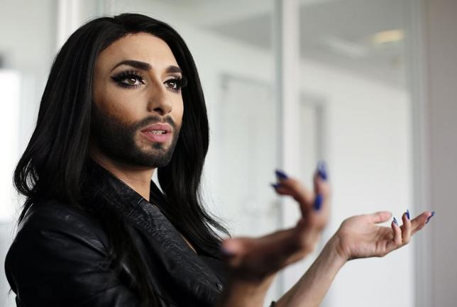 Austrian drag queen Conchita Wurst gestures during an interview with Reuters in Vienna April 24, 2014. Wurst will take to the European stage as Austria's contender for Eurovision, the song contest that pits nation versus nation and launched the global careers of ABBA and Celine Dion, Wurst's idol. Picture taken April 24, 2014. REUTERS/Leonhard Foeger