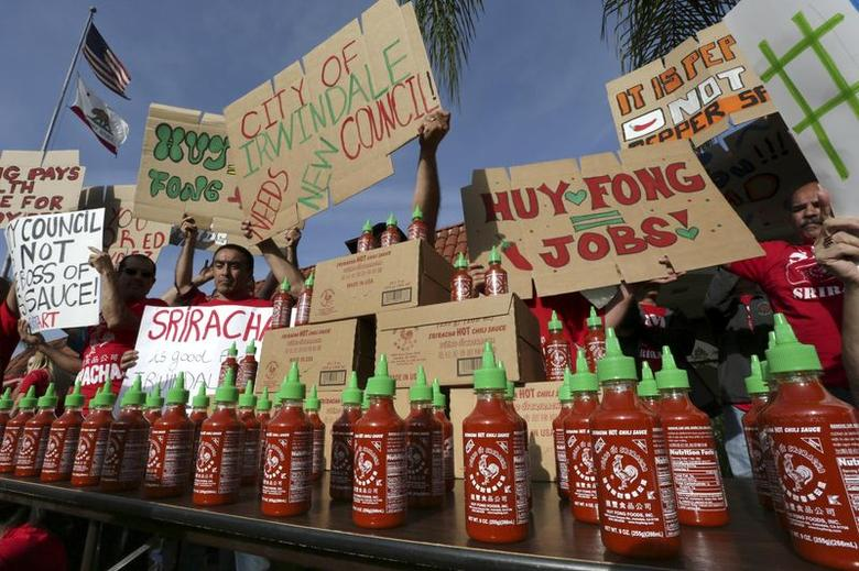Supporters of Sriracha hot sauce attend a rally at Irwindale City Hall, in Irwindale, California April 23, 2014. REUTERS/Jonathan Alcorn