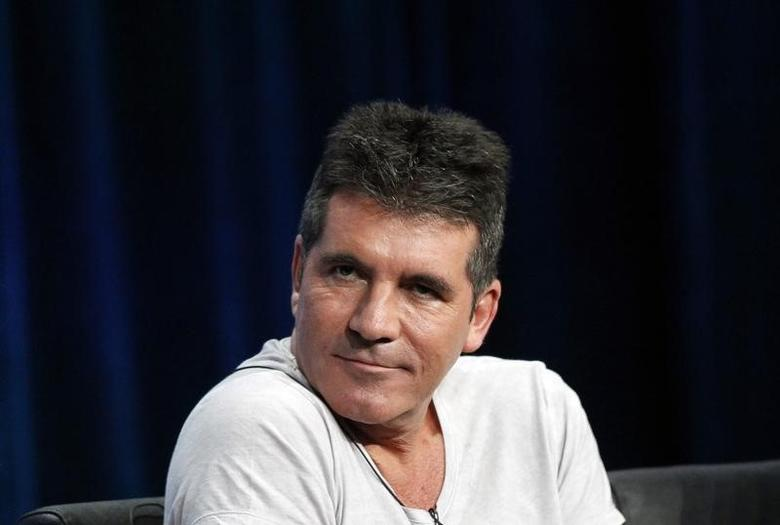 Judge Simon Cowell attends a panel for the television series ''The X Factor'' during the Fox portion of the Television Critics Association Summer press tour in Beverly Hills, California August 1, 2013.   REUTERS/Mario Anzuoni