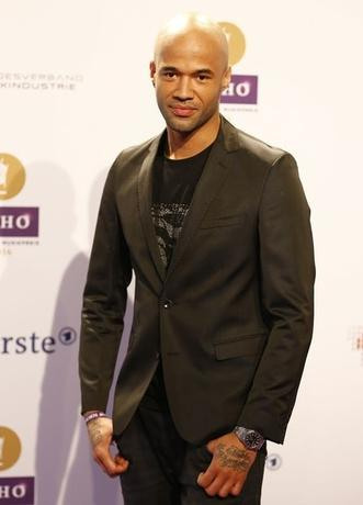 Singer Mr. Probz arrives on the red carpet for the Echo Music Awards ceremony in Berlin March 27, 2014. REUTERS/Kai Pfaffenbach/Files