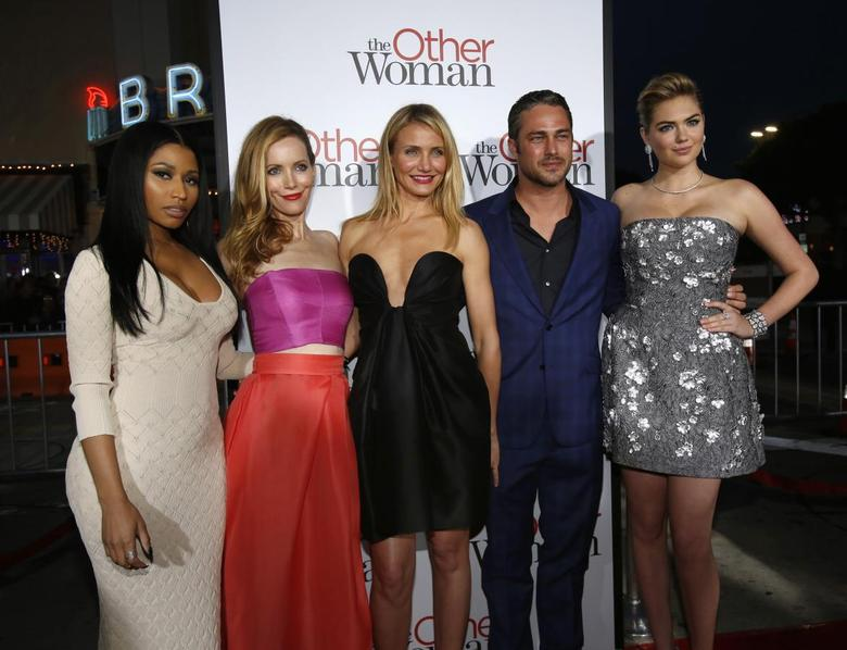 Cast members (from L-R) Nicki Minaj, Leslie Mann, Cameron Diaz, Taylor Kinney and Kate Upton pose at the premiere of the film ''The Other Woman'' in Los Angeles, California April 21, 2014. REUTERS/Mario Anzuoni