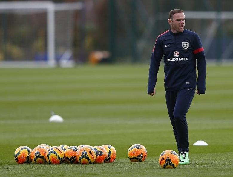 England's Wayne Rooney attends a team training session at the Tottenham Hotspur training ground in Enfield, north of London, England March 3, 2014. REUTERS/Eddie Keogh/Files