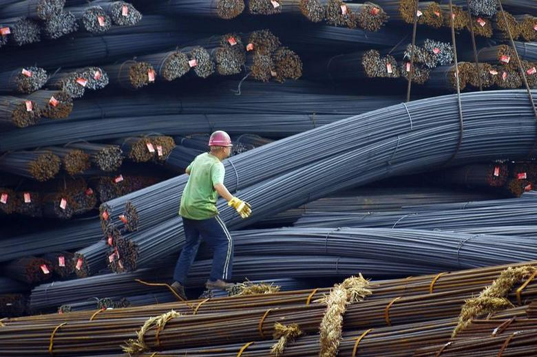 A labourer works on steel bars in Yichang, Hubei province, April 29, 2014. REUTERS/China Daily
