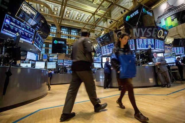 Traders work on the floor of the New York Stock Exchange April 30, 2014. REUTERS/Brendan McDermid