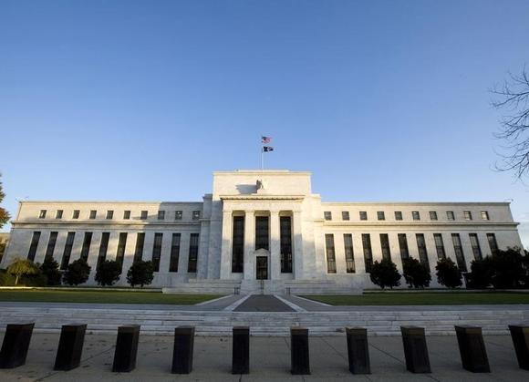 The Federal Reserve Building in Washington while the Fed is inside meeting, October 29, 2008. The Fed is expected to lower the prime rate today after two-days of meetings.    REUTERS/Larry Downing  (UNITED STATES) - RTXA1C4