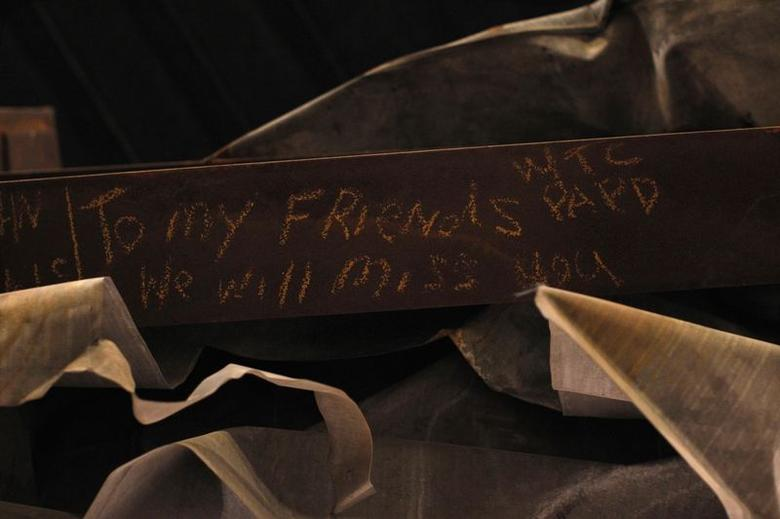 A message is seen on the bottom of the ''Cross'', intersecting steel beams found in the rubble of 6 World Trade Center that was destroyed on September 11, 2001, displayed in The National September 11 Memorial and Museum, under construction, at the World Trade Center site in New York in this September 6, 2013 file photo.  REUTERS/Brendan McDermid/Files
