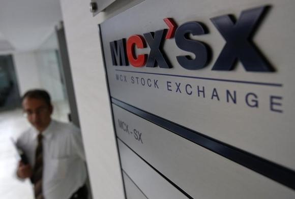 A staff member walks past the MCX-SX logo at their Exchange Square building in Mumbai February 11, 2013. REUTERS/Vivek Prakash/files